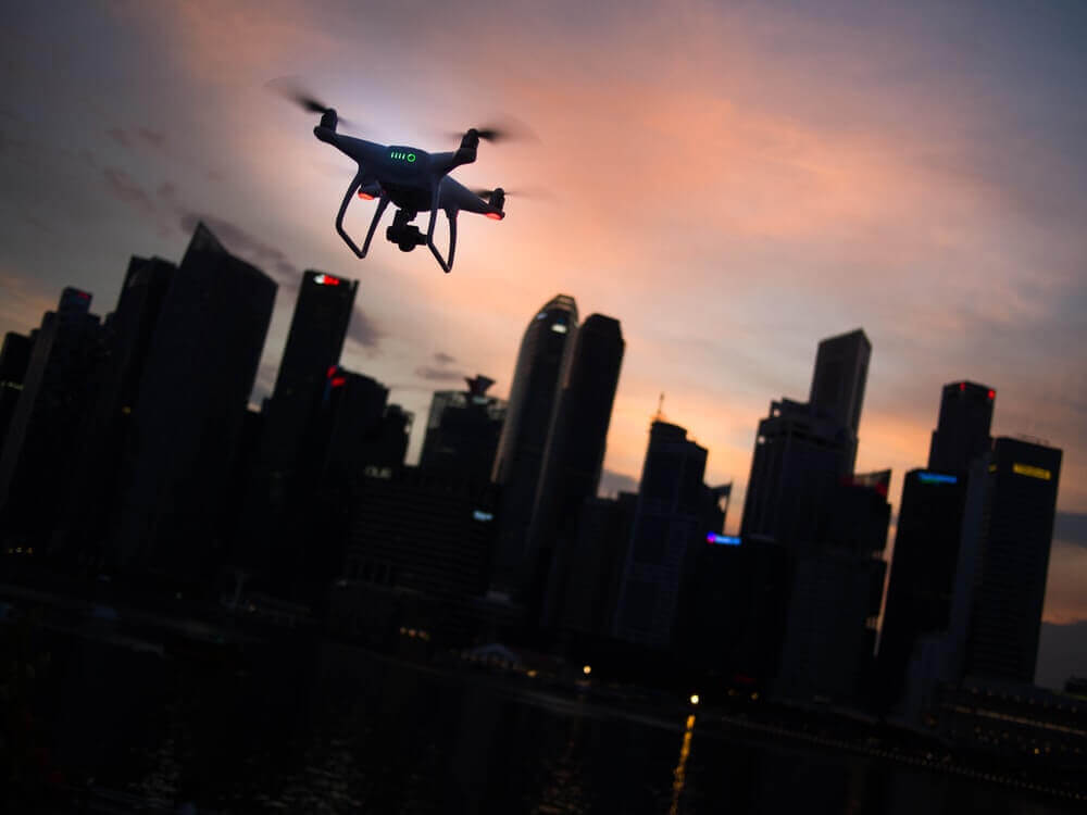 Drone flying above the city taking pictures