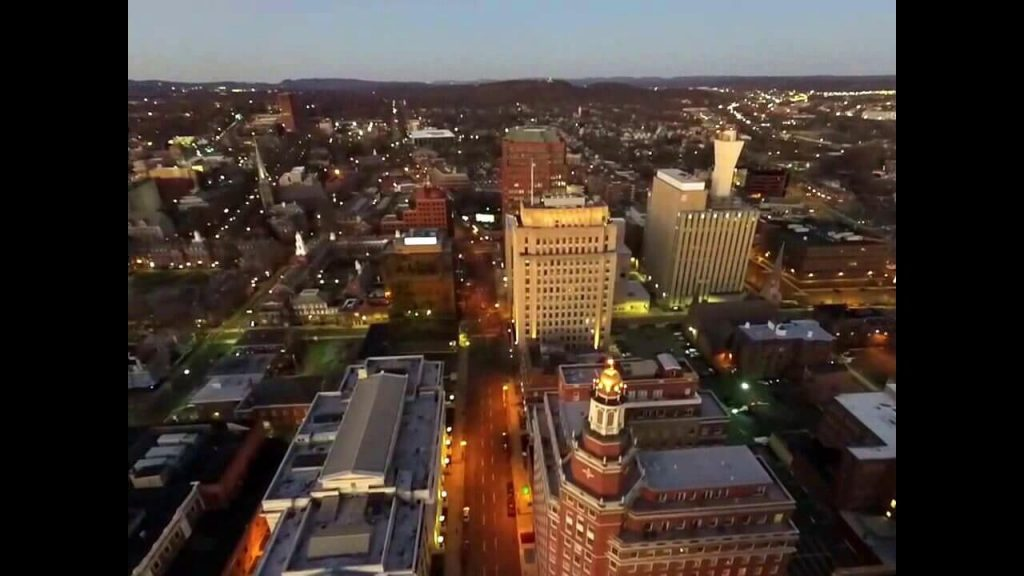 A drone taking pictures of a city flying above 400 feet.