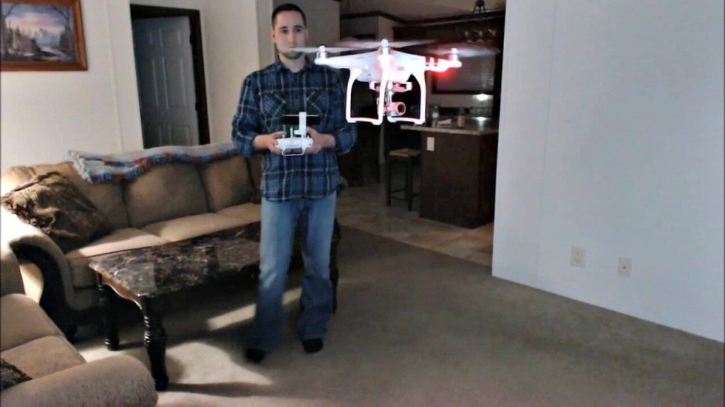 Person trying to fly his drone inside his room.