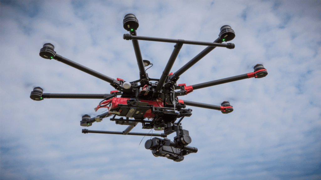 A drone with a camera shooting.