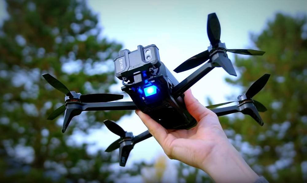 A person holding up the parrot Bebop-Pro Thermal Drone.