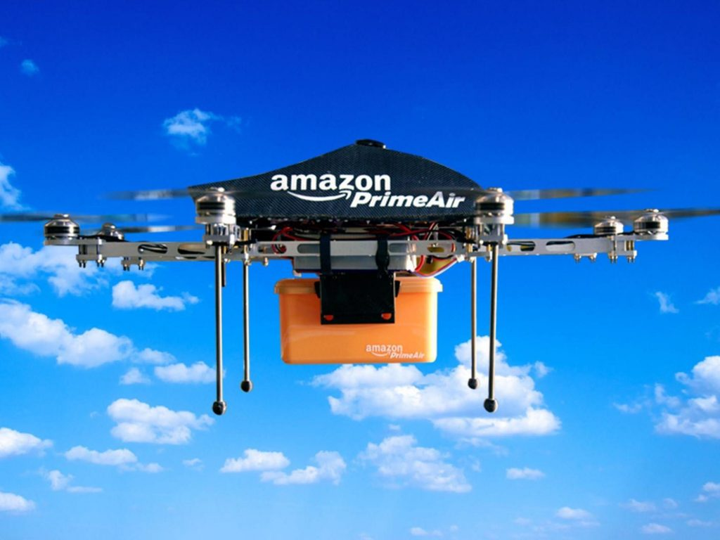 Amazon Prime Air Drone carrying a package.