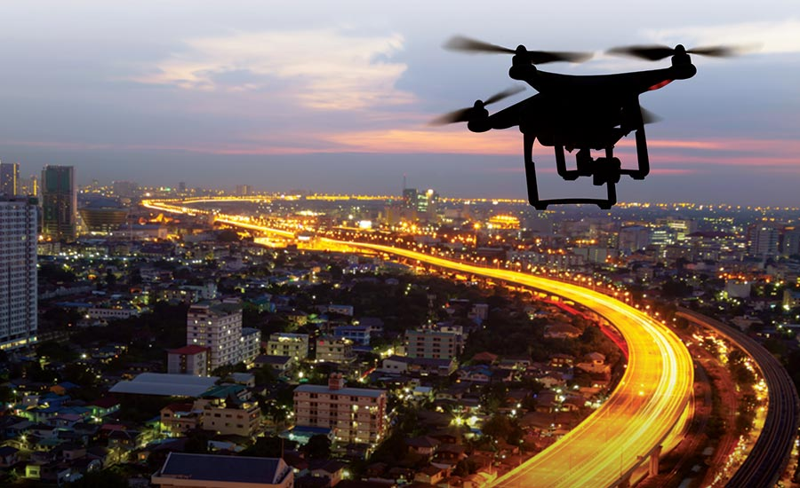 Drone flying above the city in the evening time.