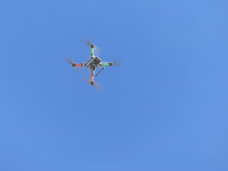 Drone flying high in the sky
