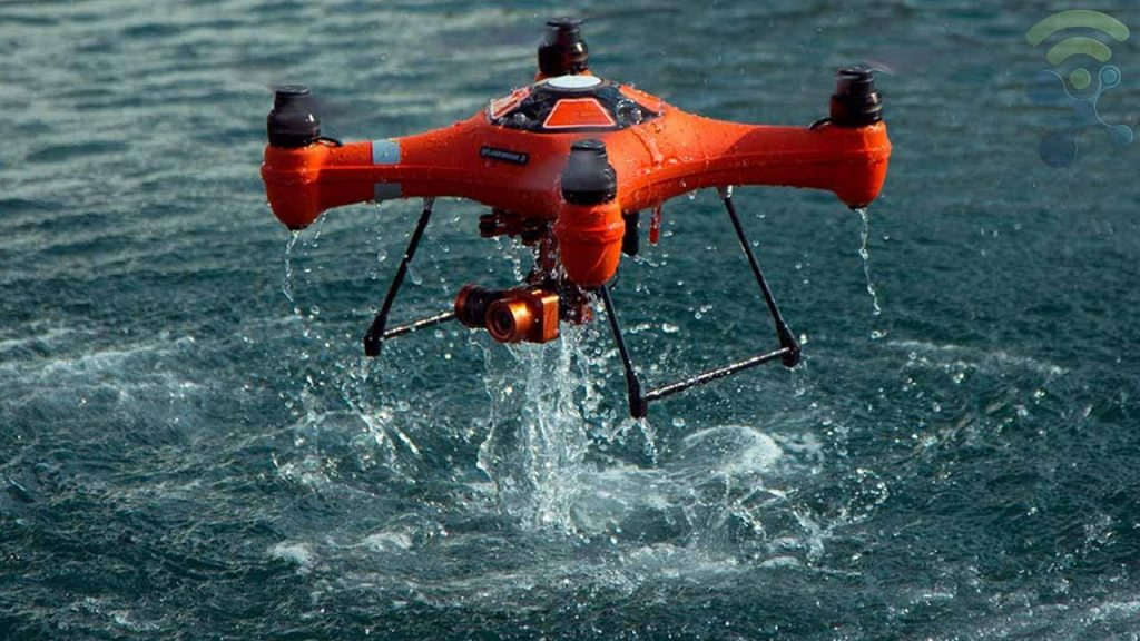 Drone in Orange color coming out of water.