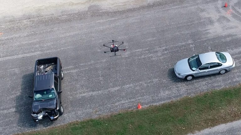 A drone flying over cars ib the hughway