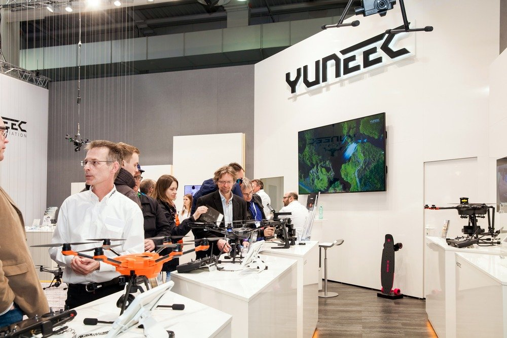 People gathered around Yunnec drones in a conference