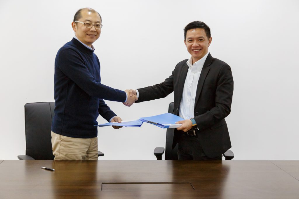 Larry Liu the CEO of Yuneec Corporate shaking hands with someone.