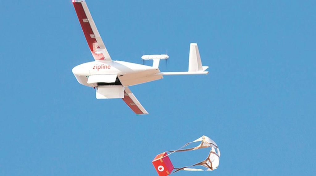 A fixed wing drone dropping off medicine