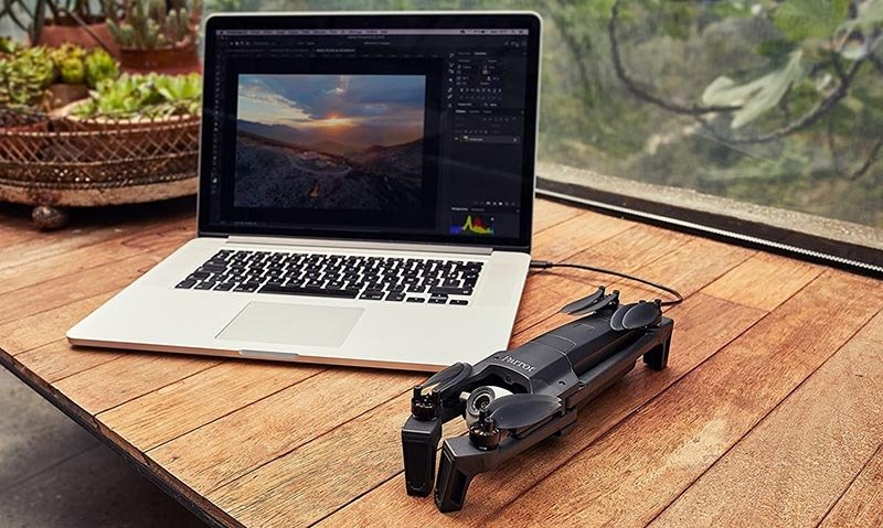 Parrot Anafi Base Drone and Apple MacBook Pro on the table
